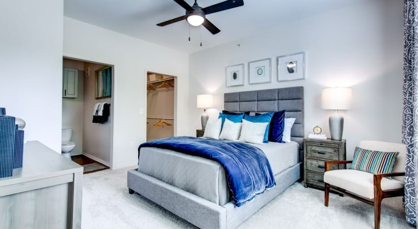 Spacious Apartment Bedroom with Ceiling Fan