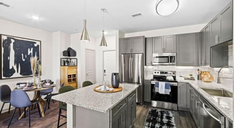 Sleek Granite Countertops at Our Cortland Flatirons Apartments in Broomfield, Colorado