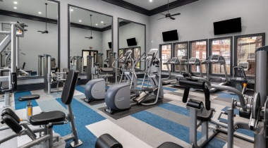 Apartment gym with HDTVs at Cortland Bryan Place