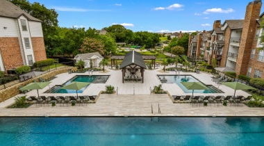 Resort-style pool with outdoor cabana at Cortland North Plano