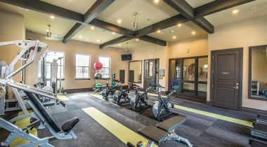 Fitness center at apartments in Farmers Branch, TX
