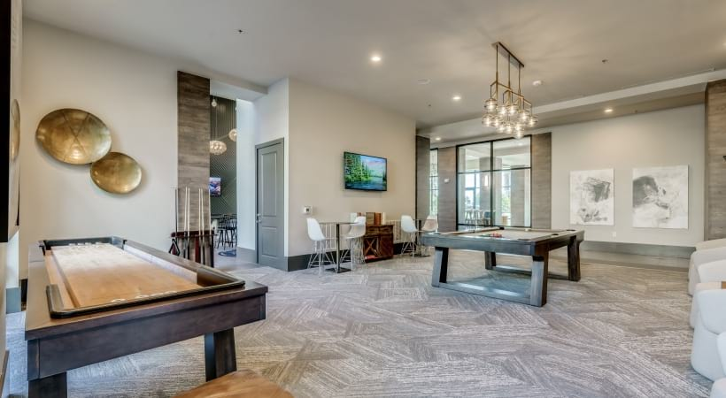 Game room with shuffleboard and billiards at our Luxury Apartments Frisco