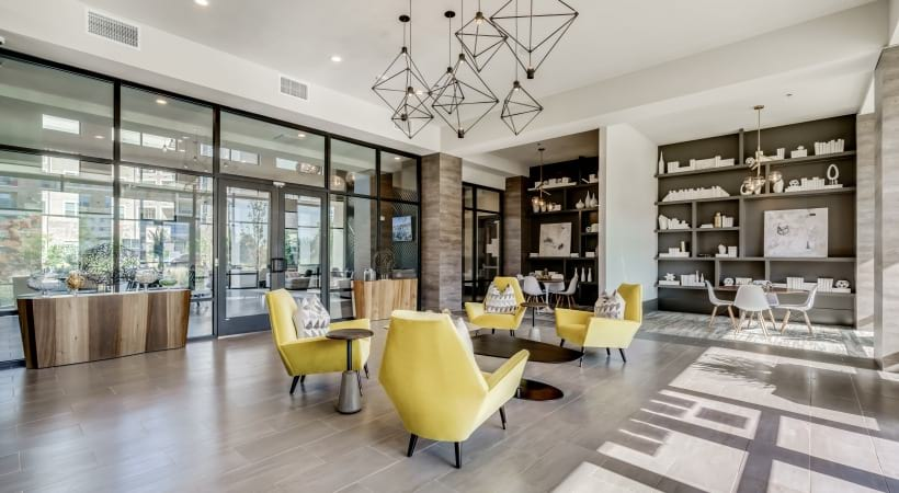 Leasing center with multiple seating areas at Circa apartments in West Plano