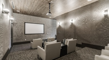 Movie theatre with comfortable seating and light-wood style seatings at Circa apartments near Frisco, TX