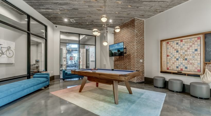 Game room with billiards at our Verus apartments near Shops at Legacy