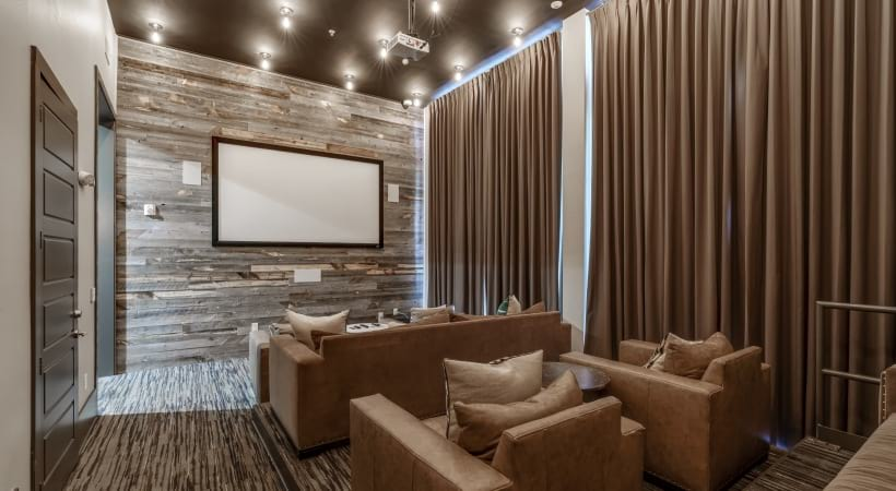 Verus apartment movie theatre with leather lounge chairs and sofas