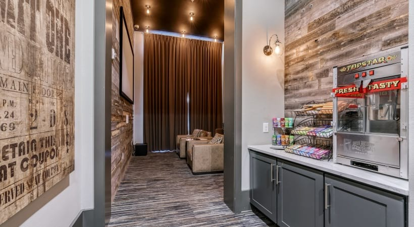 Movie theater snack bar with popcorn maker and mini concession stand at our luxury apartments in West Plano, TX