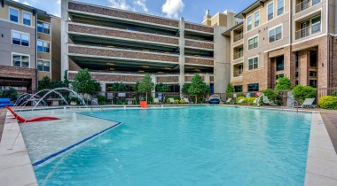 Our resort-style pool and sundeck at our upscale apartments in Frisco, TX