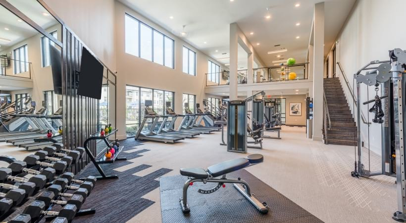 Fitness center at luxury apartments in North Fort Worth, TX