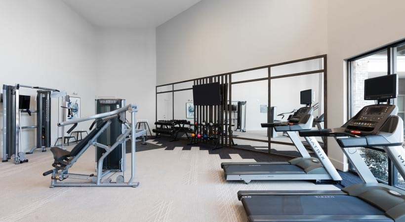 Fitness center at apartments near Fort Worth