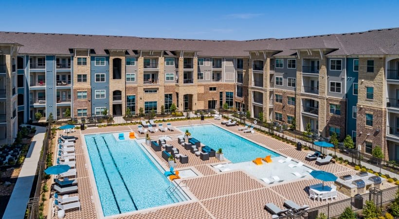 Pool and sun deck overlooking our McKinney luxury apartment building