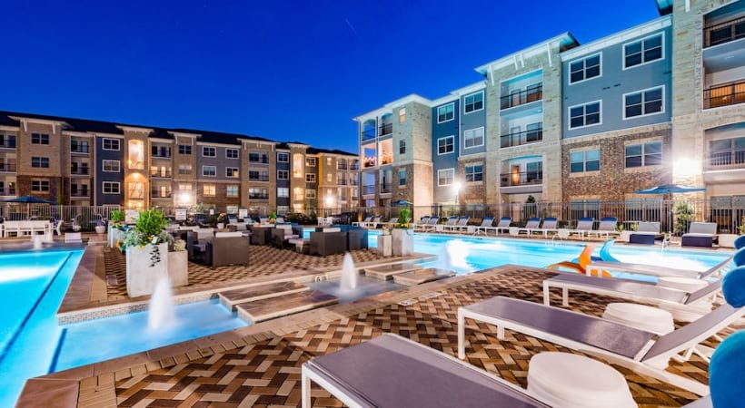 Poolside lounges at our McKinney apartment pool