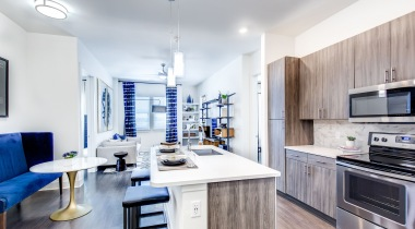 Open-concept kitchen with modern lighting at our Lone Tree apartments for rent