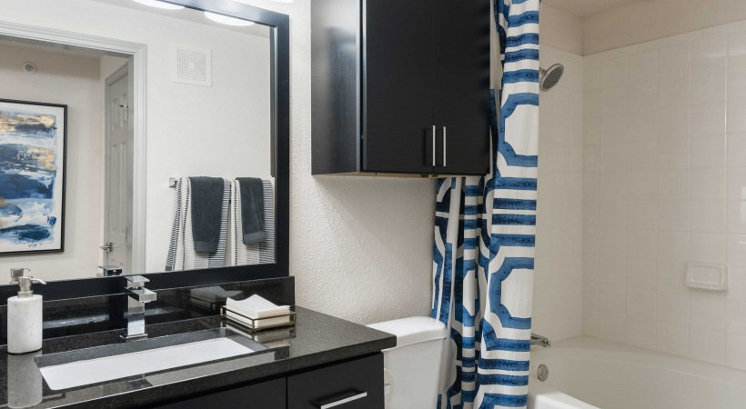 Granite Countertops and Framed Mirrors in Bathrooms