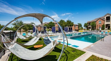 Hammocks by pool at our apartments near Alliance Town Center