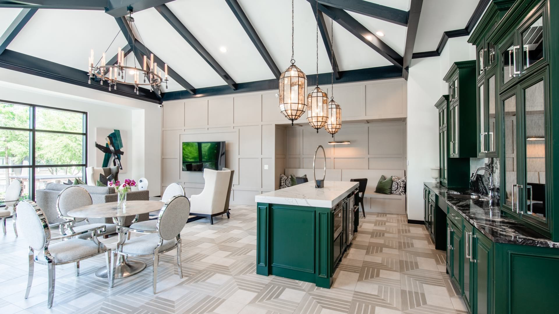 Resident clubhouse with kitchen bar and lounging area at our apartments in Irving, TX