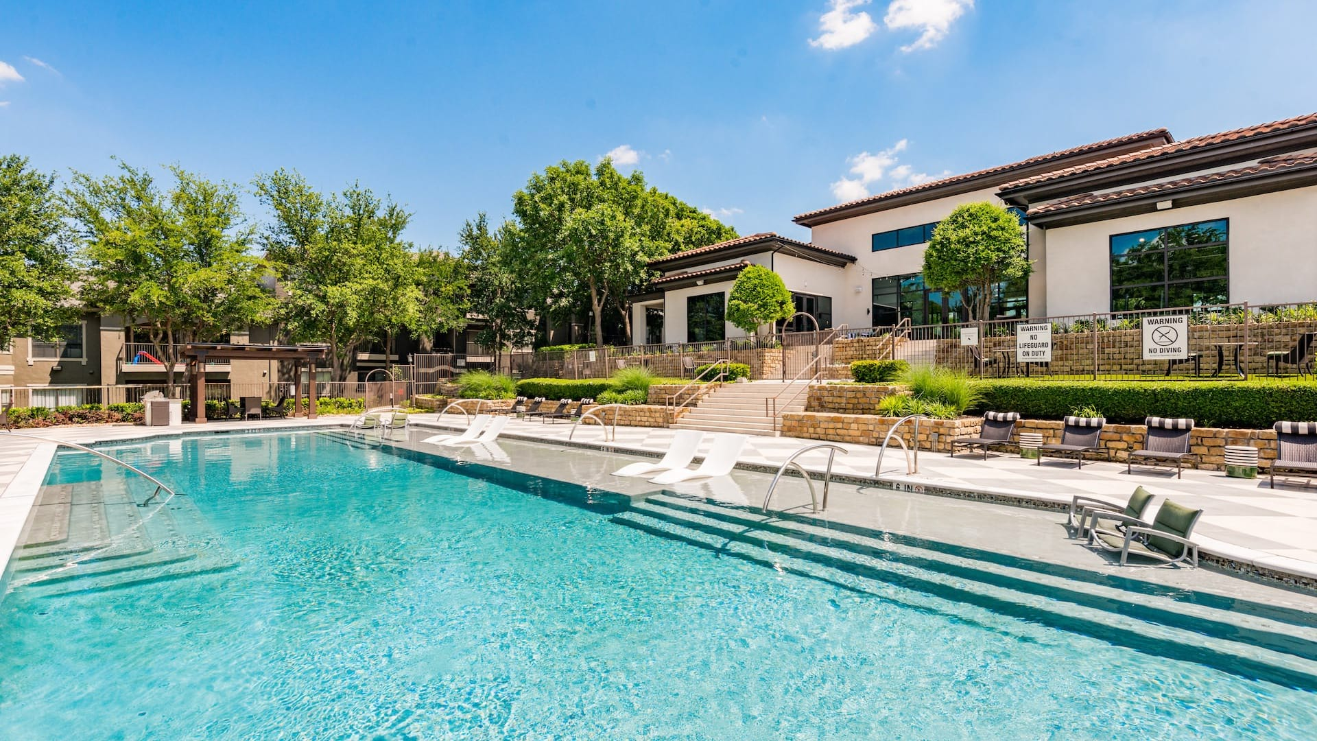 Resort-style pool with sun deck at our Irving apartments for rent