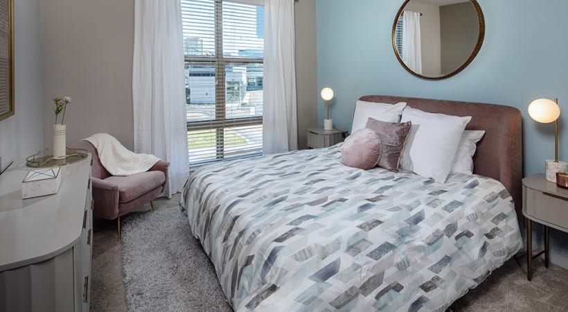 Spacious Bedroom With Large Window At Our Apartments In Brookhaven, GA