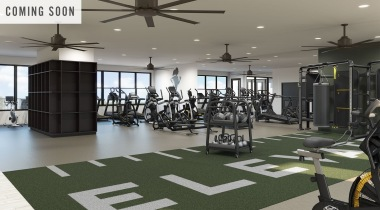 Fitness center at apartments in Plano, TX