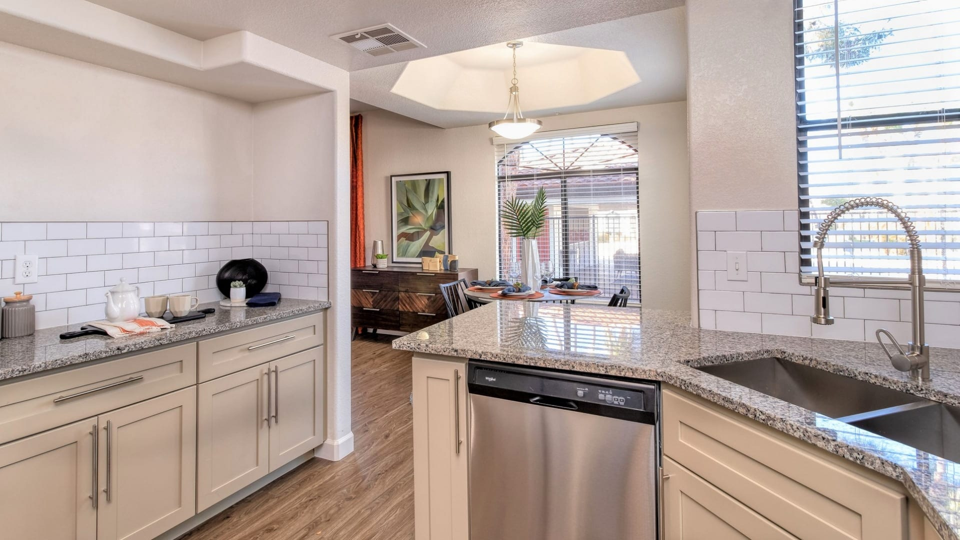 Kitchen with wide windows and granite countertops at our Chandler apartments