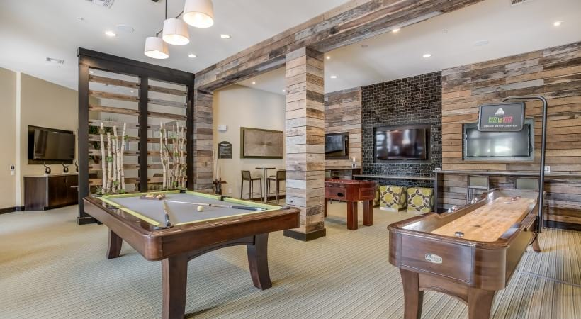 Resident lounge with game room at apartments in San Antonio