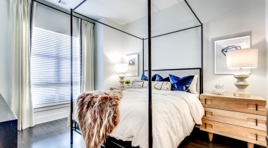 Stylish bedroom with wide windows at our apartments for rent in Lone Tree, CO