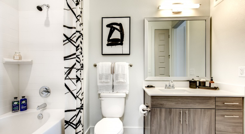 Apartment bathroom with deep soaking bathtub at our modern Lone Tree apts for rent