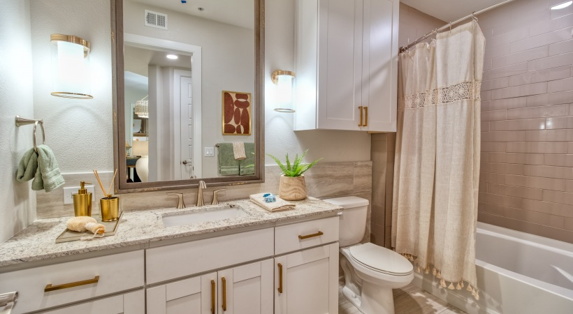 Bathrooms with Rainfall and Handheld Showerheads at Cortland Biltmore Apartments