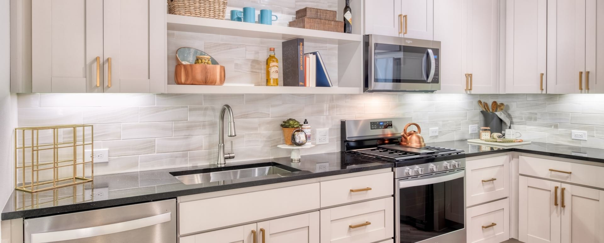 Gourmet Kitchen with Modern Lighting at Cortland Biltmore Apartments