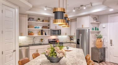 Kitchen with modern lighting at our upscale apartments in Biltmore, AZ