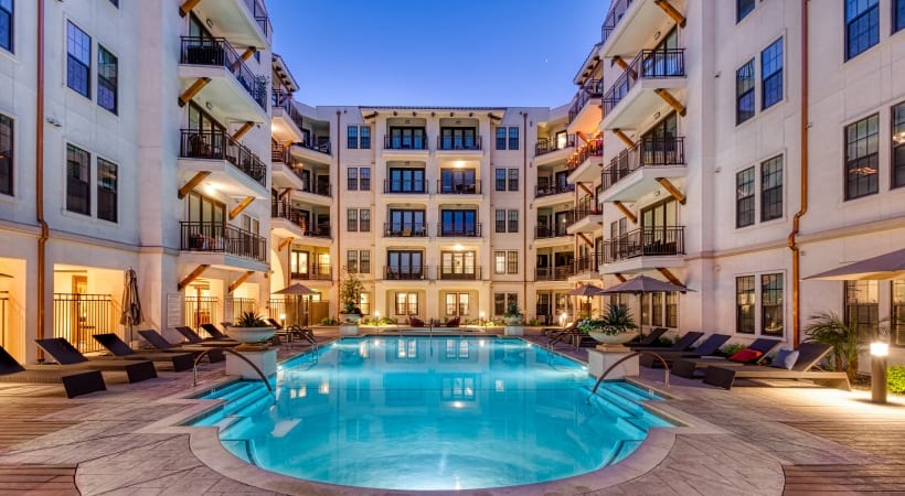 Our Camelback apartment pool with lounge area and fireplace