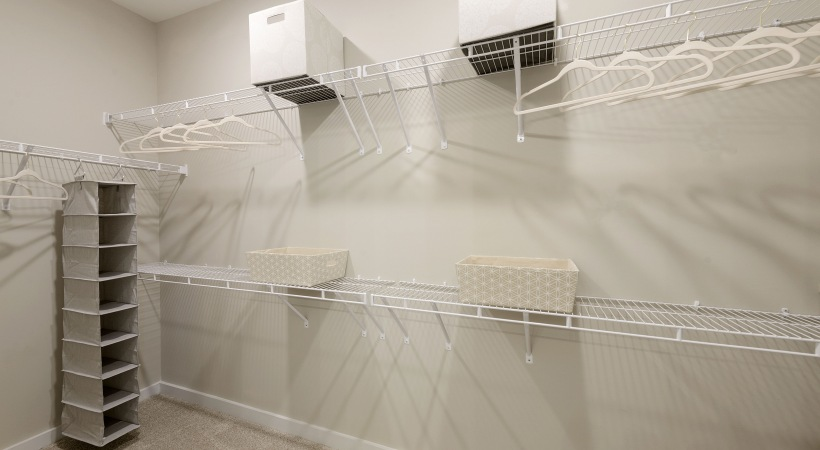Spacious walk in closet at our apartments in Durham, NC