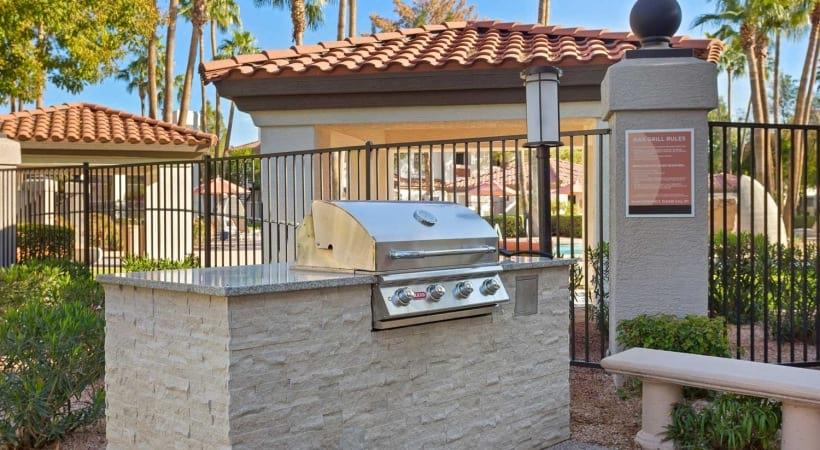Outdoor Kitchen with Gas Grills at Cortland Chandler Crossing Apartments