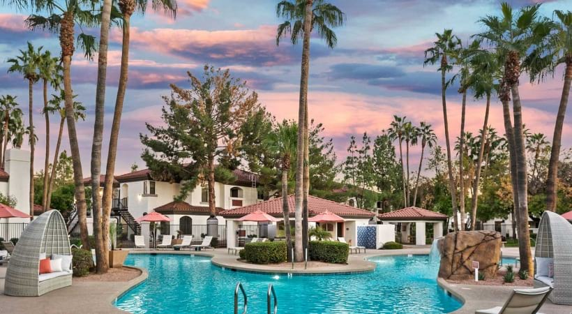 Resort-Style Pool with Outdoor Lounge at Cortland Chandler Crossing Apartments