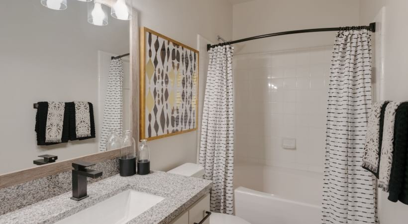 Bathroom with granite countertops at our luxury apartments in Cypress, TX