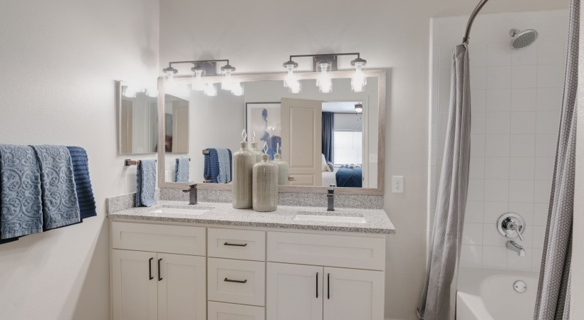 Relaxing bathroom at Copperfield apartments with double vanity