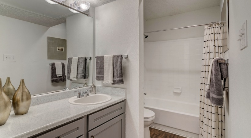 Bathroom with modern lighting at our Bear Creek apartments in Irving
