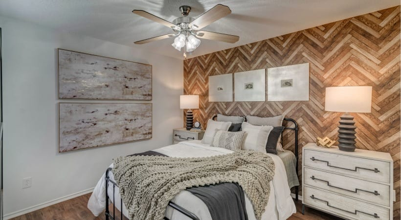Bedroom with ceiling fan at our upscale apartments in Irving, TX