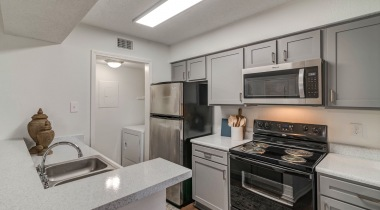 Kitchen with Stainless Steel Appliances at our Fountain Wood apartments for rent in Irving