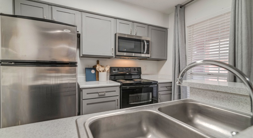 Kitchen with modern cabinetry at our Euless apartments for rent