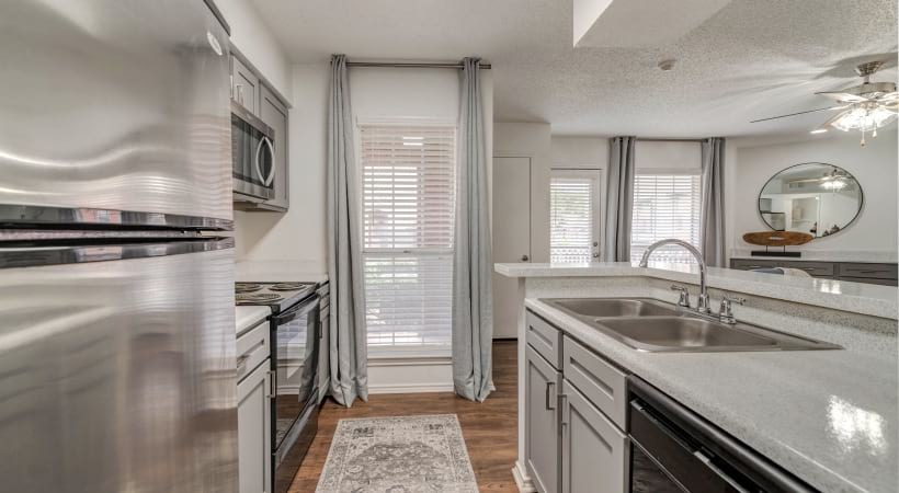 Kitchen with wide windows at our Bear Creek apartments near Irving, TX