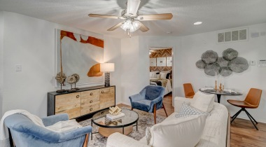 Living room with ceiling fan and modern decor at our upscale apartments in Irving, TX