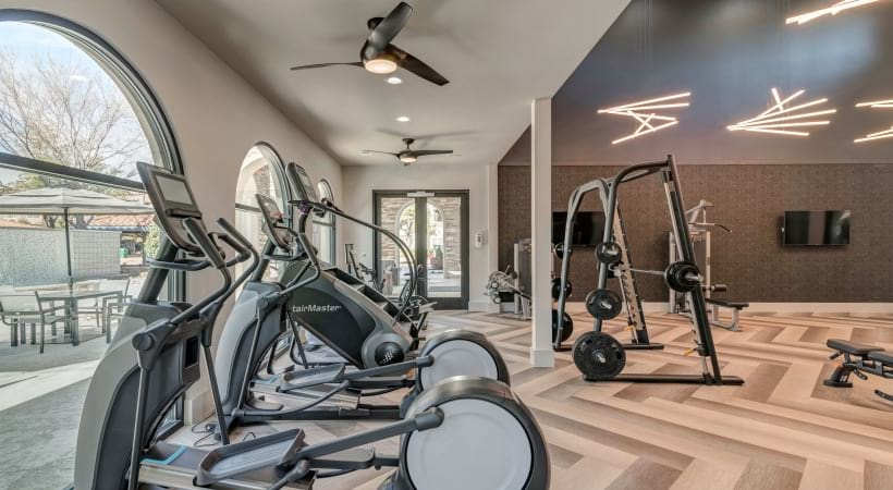 Our Las Colinas luxury apartment gym with cardio machines and others