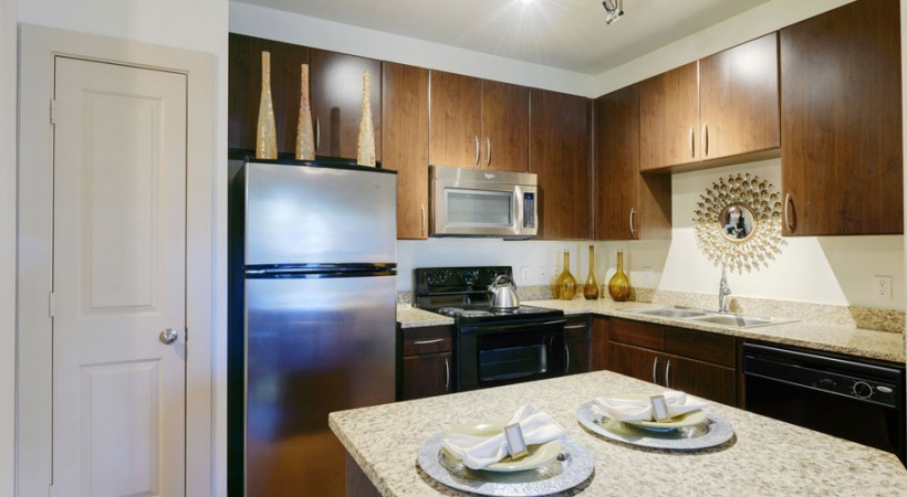Modern apartment kitchen at Cortland League City