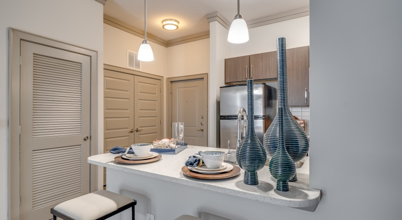 Kitchen with modern lighting at our Raleigh, NC apartments