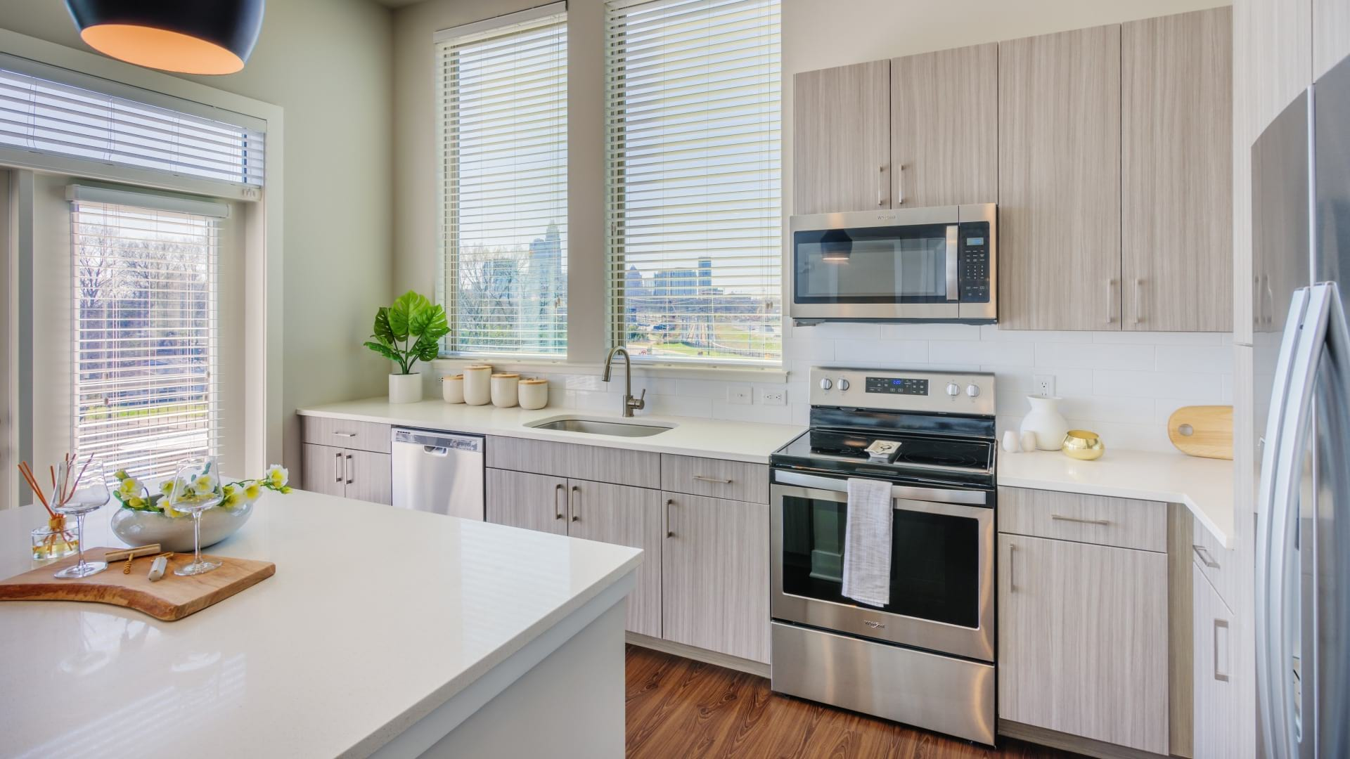 Kitchen with tall windows at our NoDa apartments in Charlotte, NC