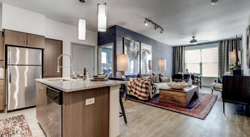 Open-concept floor plan with wood-style flooring at our luxury apartments - Colorado Springs, CO