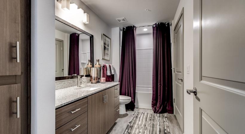 Spacious Bathroom with Granite Countertops