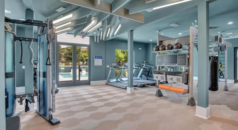 Fitness center with cardio machines at Cortland Southpark Estates