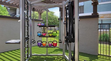 Outdoor fitness center at Cortland Southpark Estates